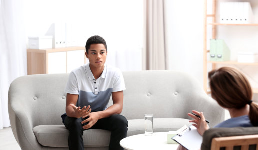 african boy and a therapist